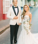 wedding couple in colombia destination wedding groom white tuxedo bride carine's bridal atelier gown