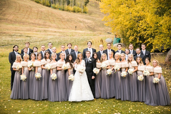 bridesmaids in purple-gray watters two-piece gowns and fur wraps, bride in isabelle armstrong, fall