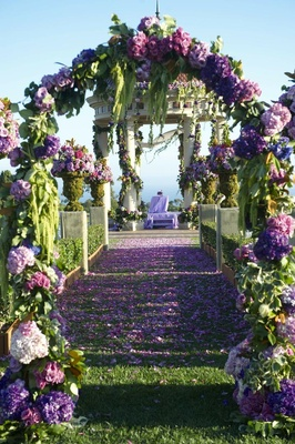 Purple and green wedding ceremony floral arch