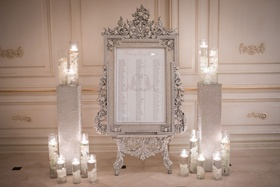 ashley alexiss wedding reception seating chart in ornate silver frame floating candles white flowers