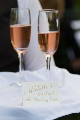 Signature cocktail in Champagne glass with rose wine
