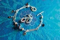 silver bracelet and earrings with blue gemstones