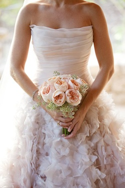 DFW Events bride Chloe wears a stunning blush ballgown by Romona Keveza.