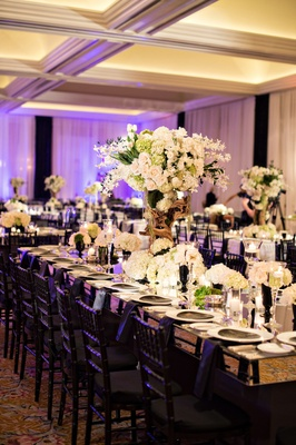 white and green flowers, modern reception décor, ballroom wedding, purple lighting black chairs