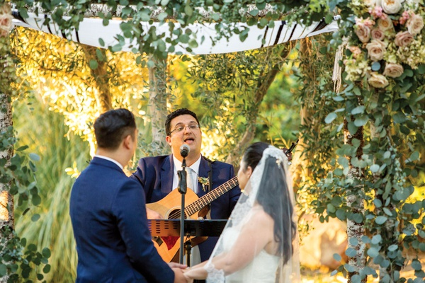 acoustic guitar performance during wedding ceremony under chuppah