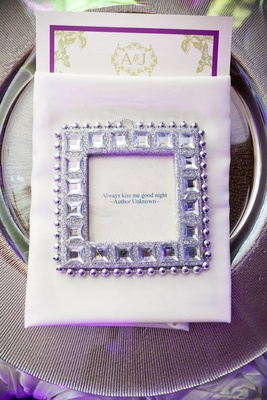 Silver charger plate topped with napkin and favor