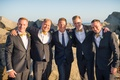 groom groomsmen different ensembles suits gray yellow navy white on beach san diego wedding