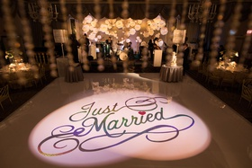 wedding reception dance floor just married heart over i paper flowers on band backdrop wedding cake