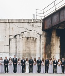 Wedding party large suits and tuxedos light purple bridesmaid dresses with matching bouquets