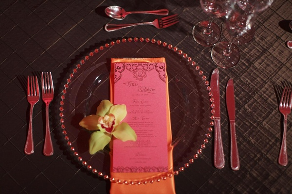 Wedding reception place setting with pink menu