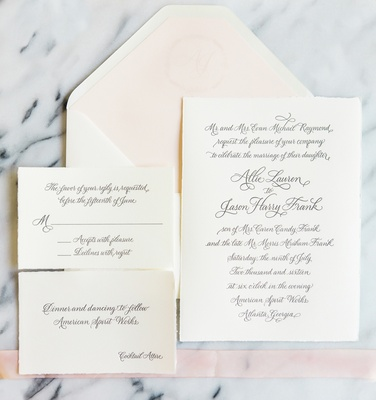 white invitations with cursive font white envelope