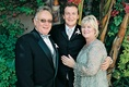 The groom with his parents outside