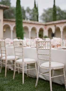 Wedding reception white wash wood chairs white linen and low centerpiece French wedding reception