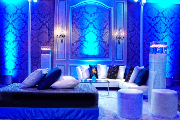 wedding reception lounge area with blue uplighting