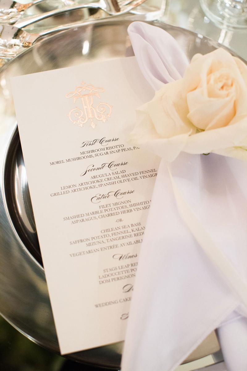 wedding reception place setting menu card rose gold foil monogram napkin white ivory rose