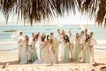 Katrina Hodgson and groom with bridesmaids and groomsmen on beach
