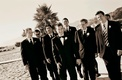 groomsmen on the sand at california beach