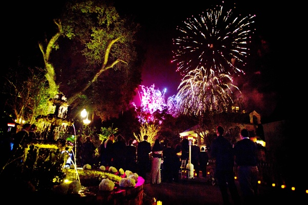 Yellow lighting at plantation wedding venue with surprise firework show for guests at reception