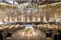wedding reception ballroom with winter wonderland theme white flowers greenery silver chairs mirror