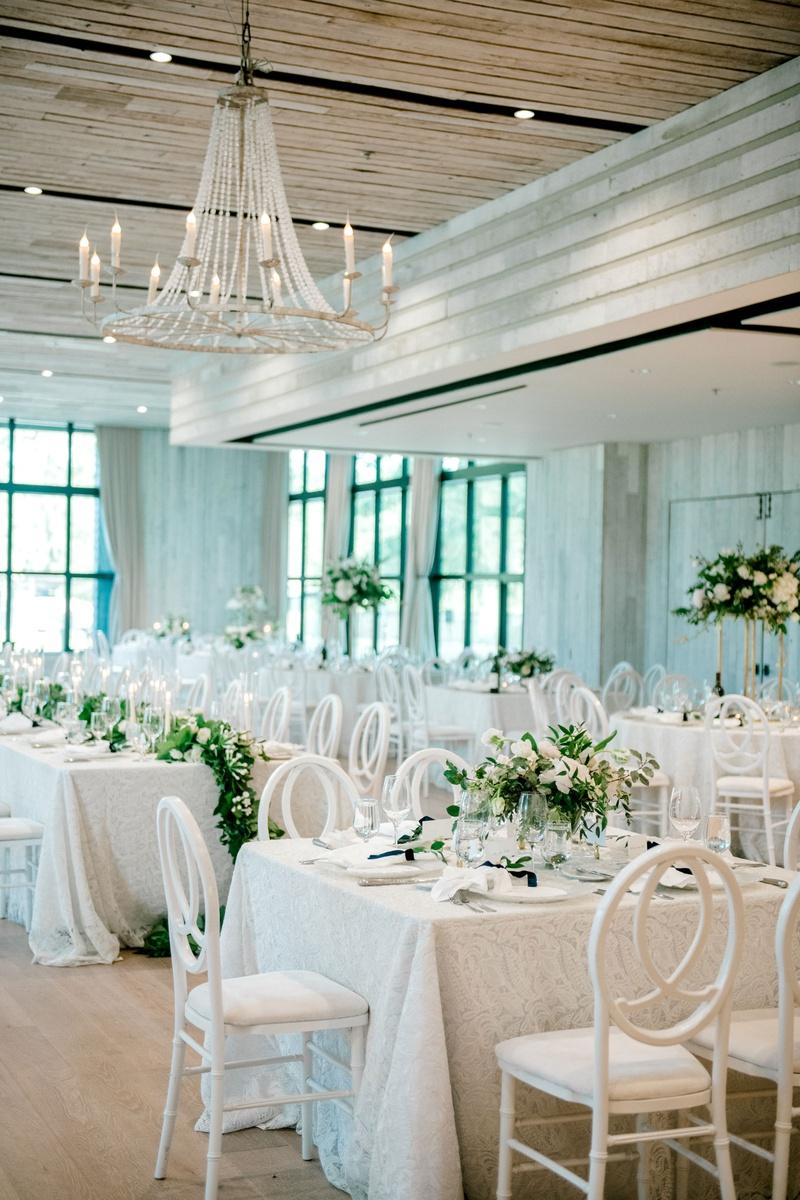 wedding reception decor white lace linen greenery white flowers wood ballroom black windows