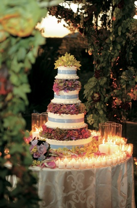 Cake table linked with candles and flowers