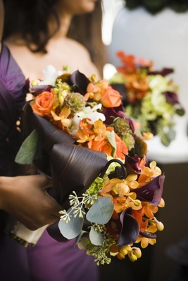 Natural bouquet with purple and orange flowers