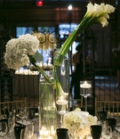 Wedding reception table with modern bouquets of white calla lilies & hydrangeas, black goblets,