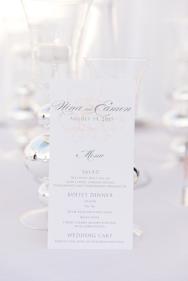 wedding reception menu with subtle pink rose drawing in background