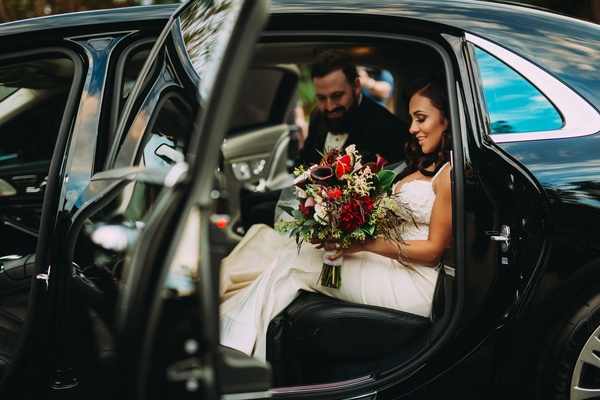 Stephanie Perez and Brandon Hampton in transportation car getaway on way to reception space hotel