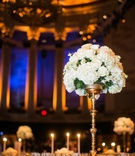 White rose and white hydrangea tall flower arrangement at Gotham Hall wedding reception