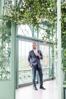 groom in generation tux in slate grey with black lapel lining