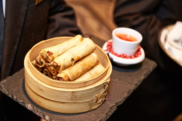 spring rolls served at cocktail hour in traditional wood bowl