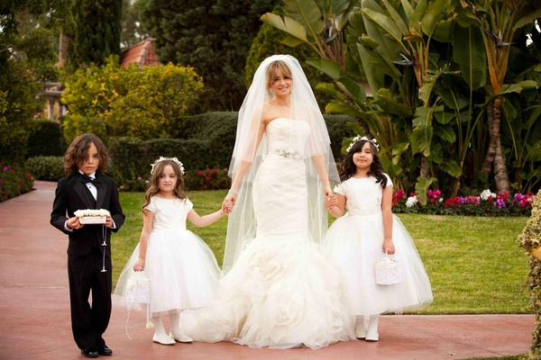 Bride holds hands with flower girls at Beverly Hills Hotel