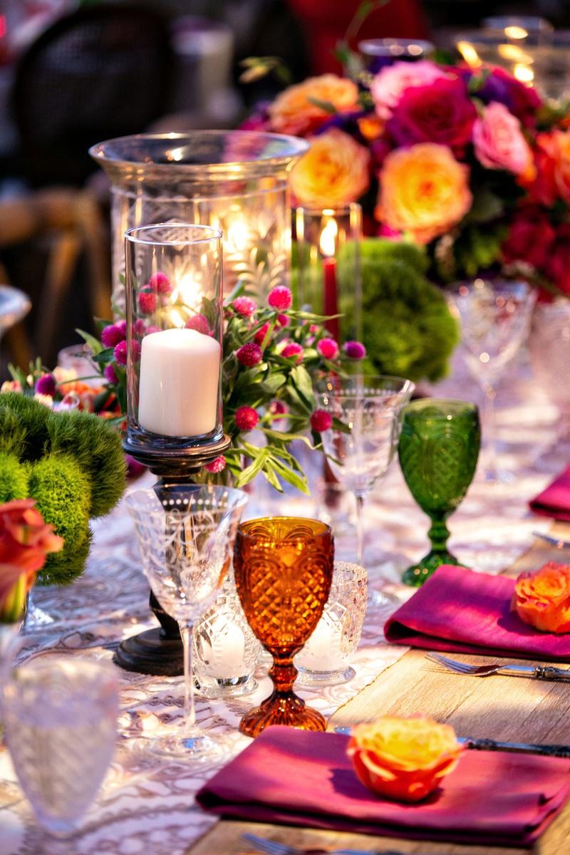 colorful wedding decor colored goblets orange green glasses etched wine glasses boho chic wedding
