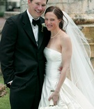 Tuxedo and strapless wedding gown with pearls