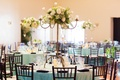 Wedding reception with Tiffany blue tablecloths, white floral arrangements