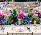Flower table runner with pink rose, pink hydrangea, green hydrangea, and purple hydrangea