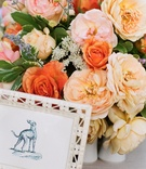 Pink, orange, and yellow rose and peony flower arrangmeent