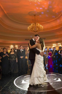 Bride and groom dancing on monogram floor