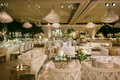 wedding reception lounge area chandeliers mirror coffee table settee sofa armchair forest