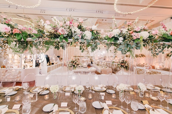 Rooftop ceremony with city views dreamy reception in st louis tall wedding centerpiece at wedding reception clear vase green leaves pink rose white junglespirit Choice Image