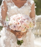 Wedding bouquet with varieties of light pink roses and garden roses flower applique marchesa dress
