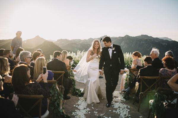 bride in strapless romona keveza wedding dress with sweetheart neckline, groom in hugo boss tuxedo