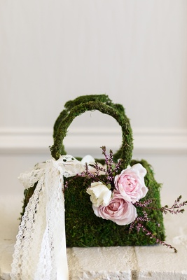 moss flower girl purse basket with pink flowers and a lace bow