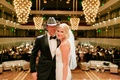 bride in inbal dror mermaid wedding dress with tim mcgraw at wedding reception