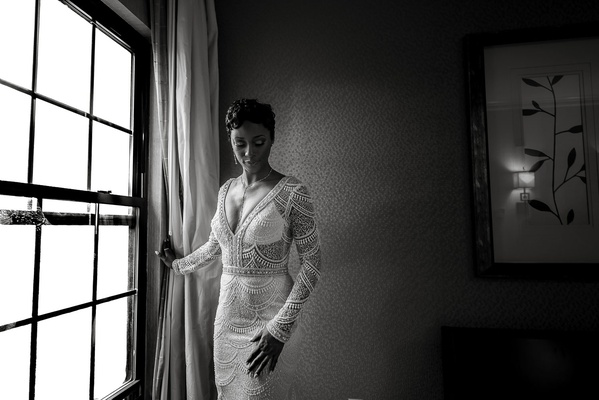 black and white photo of bride in lace berta wedding dress