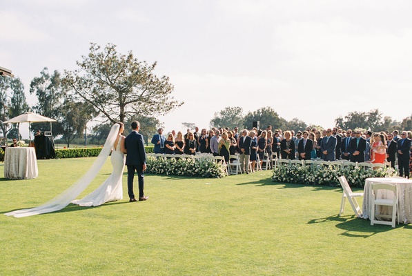 wedding processional at the lodge at torrey pines outdoor wedding ceremony cathedral veil