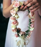 Flower girl holding her floral crown
