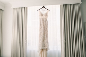 sleeveless v-neck lace gown with nude lining hanging in the window
