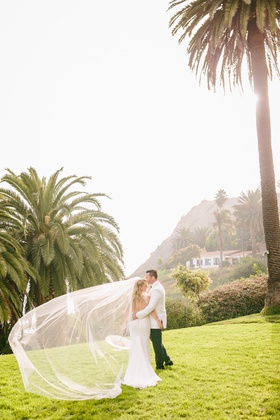 southern california wedding, bride in ines di santo wedding gown, cathedral veil, paper parasol